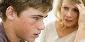 Teenager listening to mother speak